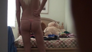 Cute blonde messy girl with the trimmed pussy is posing stripped