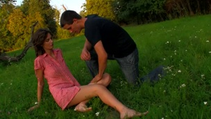 Horny legal age teenager chick copulates on a fallen treen outdoors with partner