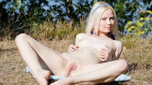 The blond cutie in this beautiful porn movie was sunbathing in nature's garb when this babe suddenly felt so very horny..
