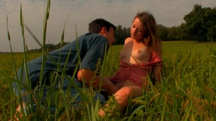 Horny legal age teenager pair makes out with each other under blue sky
