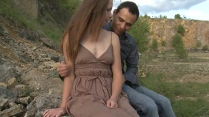 Legal Age Teenager whore copulates with her partner outdoors on a giant stone