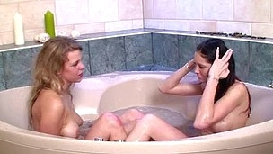 Blond and brunette sexy girls share dick of guy in Jacuzzi
