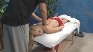 Masseur is sliding the fingers along the cute oily back of bitch